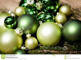 shiny green baubles closeup macro and tree stock photo