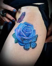 mind blowing blue butterfly on thigh truetattoos