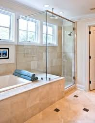 Cherry Wood Vanity And Large Glass Shower And Bathtub Enclosure - Bathroom tub and shower designs