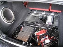 can i install an aftermarket amp and sub while using the stock