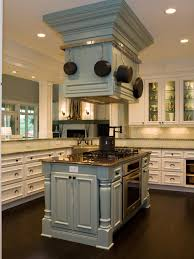in this transitional kitchen a pale blue island houses the oven