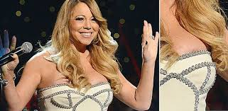 mariah carey suffers a nip slip wardrobe malfunction mirror online