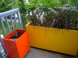contemporary planter boxes with nice yellow and orange painting