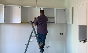 how to hang a cabinet to the wall how to install wall cabinets the home depot
