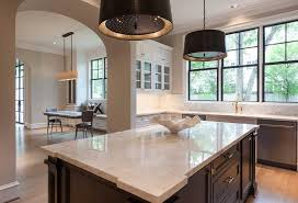 white kitchen with black island white kitchen with black center island and black pendants