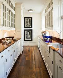 white kitchen wood floors galley kitchen wood floors white cabinets glass cabinets above