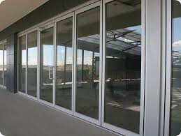 commercial exterior glass doors company that makes thermal insulated polycarbonate folding doors