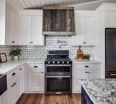 black kitchen cabinets with white subway tile backsplash classically clean a black white kitchen masterpiece