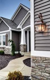 love this exterior house design with stone and gray hair and
