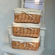 white wicker baskets wooden toys wicker baskets and books on