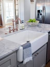 grey cabinet and white undermounted sink using traditional copper