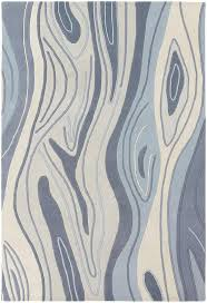 inhabit collection tufted area rug blue wood grain design by