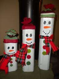 country christmas snowmen made from landscape timber pieces knit
