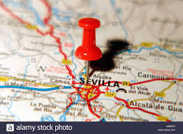 Spain On A World Map by Map Pin Pointing To Seville Spain On A Road Map Stock Photo