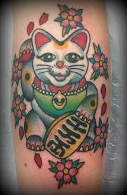 tattoo cat neko maneki neko tattoos the meanings behind a gesture tattoo life