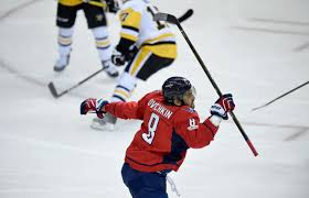 ovechkin scores twice passes 1 000 points as caps beat pens