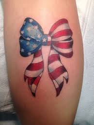 american flag bow tattoo on leg