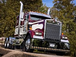 a tricked out kenworth w900 photographed on a bridge outside of