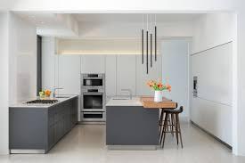 kitchen 2 tier grey kitchen island with black iron bar stools