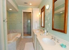 bathroom with framed wall mirrors and starfish accessories