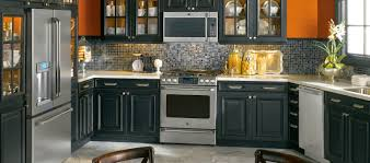 white kitchen cabinets with black appliances sophisticated kitchen