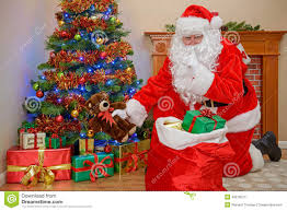 santa delivering christmas presents stock photo image 48276573