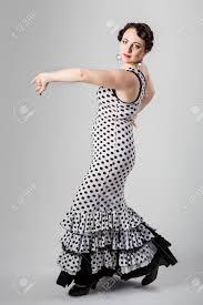 young beautiful brunette female spanish flamenco dancer in black