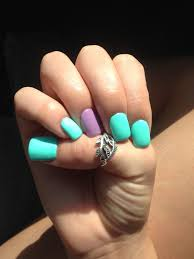 bright turquoise and purple acrylic nails perfect for summer