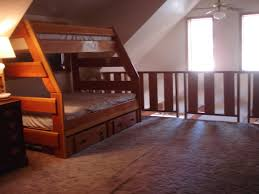 maple lodge camp maranatha retreat center idyllwild ca an upstairs loft furnished with two bunk beds this one is a double on the bottom with a single on top and the second bunk are both single beds