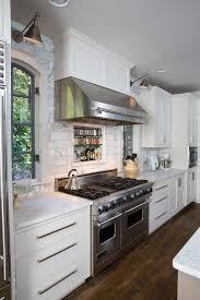 kitchen hood flanked by windows design ideas