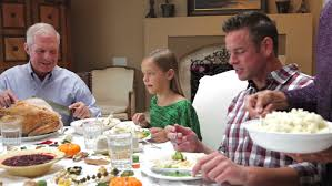 black family outside at a dinner table stock footage