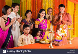 home decoration of ganesh festival indian family performing ganesh puja on ganesh chaturthi or ganesh