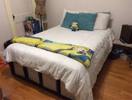 Instructables Platform Bed - she put three bookshelves from ikea sideways on the floor to make