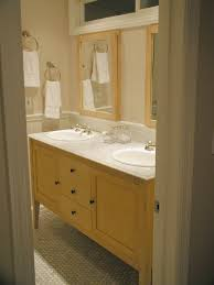 maple vanity with light sink like the framed mirrors and