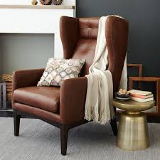 brown leather wingback chair and brass side table excited for my