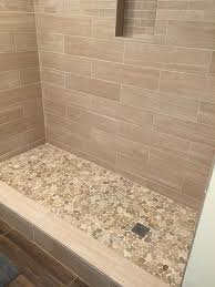 showers sliced java tan pebble tile shower floor 2