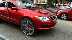 candy red volkswagen cc lifted on 26