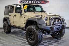 jeep wrangler jacked up matte black custom jeep wranglers for sale rubitrux jeep conversions aev