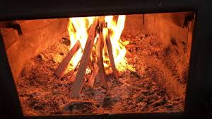 how to start a fire in a wood stove youtube
