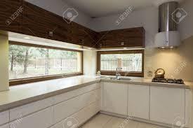 modern kitchen interior design long beige counter top in modern kitchen interior stock photo