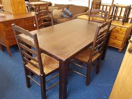 solid dark stained pine kitchen table and 4 chairs in motherwell