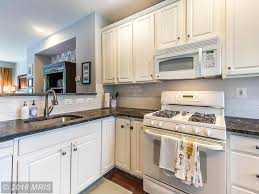 White Kitchen Cabinets With Soapstone Countertops Traditional Kitchen With Raised Panel U0026 High Ceiling In Washington