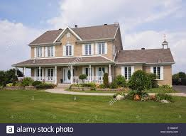 beige brick with white trim cottage style residential home in