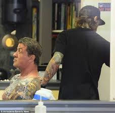 sly stallone 66 adds to his body art collection at private