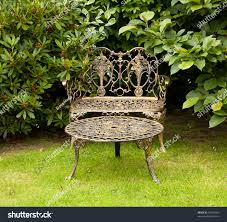 Metal Lawn Chairs Old Fashioned by Old Fashioned Gold Colored Cast Iron Stock Photo 59920453