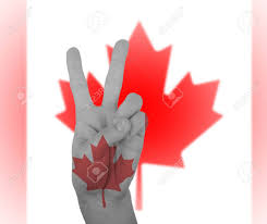 Flag Of Canada Hand Peace Sign Wrapped In The Flag Of Canada Stock Photo