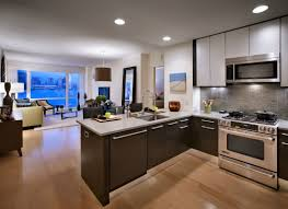 white gloss cabinetry modern appliances small apartment kitchen