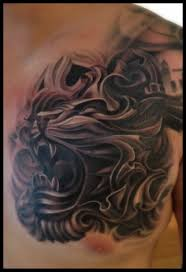 large lion roar tattoo on chest real photo pictures images and