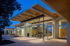 glass walls wooden ceilings and large overhang usual house