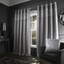glitzy sequin fully lined eyelet curtains silver grey